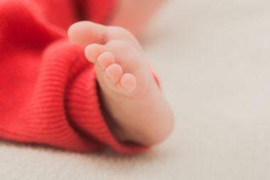 無印良品のベビー服を着た赤ちゃん